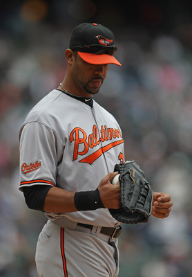 CHICAGO, IL - MAY 01: Derrek Lee #25 of the Baltimore Orioles waits to warm-up before the start of an inning against the Chicago White Sox at U.S. Cellular Field on May 1, 2011 in Chicago, Illinois. The Orioles defeated the White Sox 6-4. (Photo by Jonath
