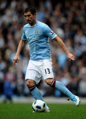 MANCHESTER, ENGLAND - APRIL 03:   Aleksandar Kolarov of Manchester City in action during the Barclays Premier League match between Manchester City and Sunderland at the City of Manchester Stadium on April 3, 2011 in Manchester, England.  (Photo by Laurenc