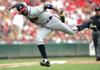 ST. LOUIS - AUGUST 6:  Third baseman Wilson Betemit #24 of the Atlanta Braves throws to first base against the St. Louis Cardinals on August 6, 2005 at Busch Stadium in St. Louis, Missouri. The Braves defeated the Cardinals 8-1.  (Photo by Dilip Vishwanat