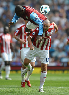 BIRMINGHAM, ENGLAND - APRIL 23: Emile Heskey of Aston Villa battles for the ball with Marc Wilson of Stoke City during the Barclays Premier League match between Aston Villa and Stoke City at Villa Park on April 23, 2011 in Birmingham, England.  (Photo by