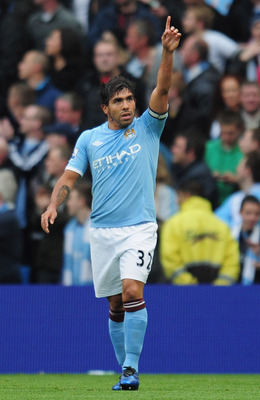 MANCHESTER, ENGLAND - MAY 17:  Carlos Tevez of Manchester City celebrates after scoring during the Barclays Premier League match between Manchester City and Stoke City at City of Manchester Stadium on May 17, 2011 in Manchester, England.  (Photo by Shaun