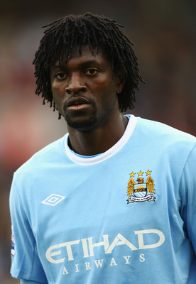 BARNSLEY, ENGLAND - AUGUST 01:  Emanuel Adebayor of Manchester City looks on during the Pre Season Friendly match between Barnsley and Manchester City at the Oakwell Stadium on August 1, 2009 in Barnsley, England.  (Photo by Matthew Lewis/Getty Images)