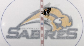 BUFFALO, NY - FEBRUARY 13: Adam Mair #22 of  the Buffalo Sabres skates over the center ice emblem during play against the Toronto Maple Leafs on February 13, 2008 at HSBC Arena in Buffalo, New York.  (Photo by Rick Stewart/Getty Images)