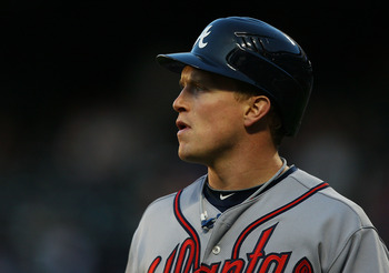 NEW YORK - APRIL 23:  Nate McLouth #24 of the Atlanta Braves walks back to the bench after striking out in the first inning against the New York Mets on April 23, 2010 at Citi Field in the Flushing neighborhood of the Queens borough of New York City. Mets
