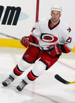 SUNRISE, FL - SEPTEMBER 19:  Right wing Jeff Heerema #21 of the Carolina Hurricanes skates against the Florida Panthers during the preseason NHL game on September 19, 2003 at the Office Depot Center in Sunrise, Florida. The Panthers defeated the Hurricane