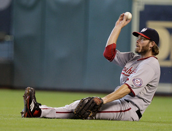 HOUSTON, TX - JULY 20: Right fielder Jayson Werth #28 of the Washington Nationals fields Humberto Quintero #55 of the Houston Astros single in the 11th on July 20, 2011 at Minute Maid Park in Houston, Texas. Quintero scored the winning run. Astros won in