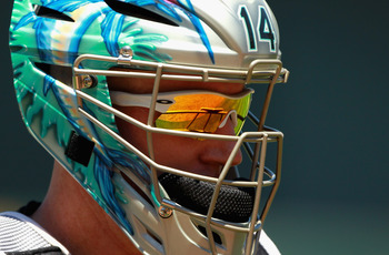 OAKLAND, CA - JUNE 30:  Catcher John Buck #14 of the Florida Marlins walks back to the dugout after the fifth inning of their game against the Oakland Athletics at Oakland-Alameda County Coliseum on June 30, 2011 in Oakland, California.  (Photo by Ezra Sh