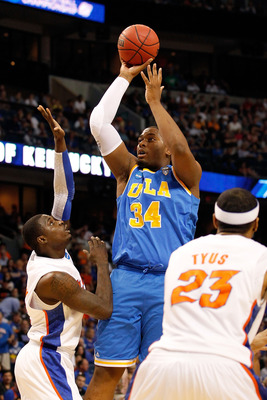 TAMPA, FL - MARCH 19:  Joshua Smith #34 of the UCLA Bruins attempts a shot in the first half against Vernon Macklin #32 of the Florida Gators during the third round of the 2011 NCAA men's basketball tournament at St. Pete Times Forum on March 19, 2011 in
