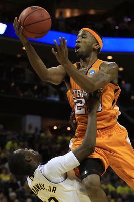 CHARLOTTE, NC - MARCH 18:  Cameron Tatum #23 of the Tennessee Volunteers goes up for a shot against Tim Hardaway Jr. #10 of the Michigan Wolverines in the second half during the second round of the 2011 NCAA men's basketball tournament at Time Warner Cabl