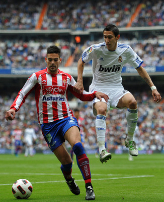 MADRID, SPAIN - APRIL 02:  Angel Di Maria (R) of Real Madrid duels for the ball with Alberto Botia of Sporting Gijon during the la Liga match between Real Madrid and Sporting Gijon  at Estadio Santiago Bernabeu on April 2, 2011 in Madrid, Spain.  (Photo b