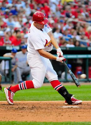 ST. LOUIS, MO - JUNE 18: Matt Holliday #7 of the St. Louis Cardinals connects with a double against the Kansas City Royals at Busch Stadium on June 18, 2011 in St. Louis, Missouri.  (Photo by Jeff Curry/Getty Images)