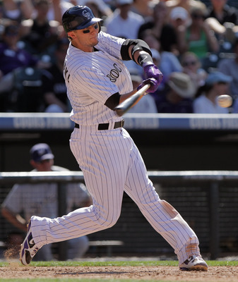 DENVER, CO - JULY 17:  Troy Tulowitzki #2 of the Colorado Rockies takes an at bat against the Milwaukee Brewers at Coors Field on July 17, 2011 in Denver, Colorado.  (Photo by Doug Pensinger/Getty Images)