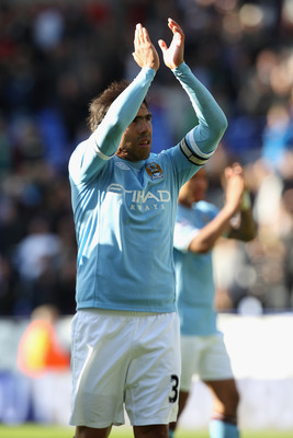 BOLTON, ENGLAND - MAY 22: Carlos Tevez of Manchester City applauds the visiting fans after his sides 2-0 victory during the Barclays Premier League match between  Bolton Wanderers and Manchester City at the Reebok Stadium on May 22, 2011 in Bolton, Englan