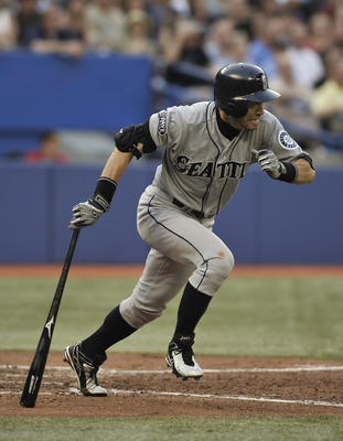 TORONTO, CANADA - JULY 20:  Ichiro Suzuki #51 of the Seattle Mariners runs to first base during MLB game action against the Toronto Blue Jays July 20, 2011 at Rogers Centre in Toronto, Ontario, Canada. (Photo by Brad White/Getty Images)