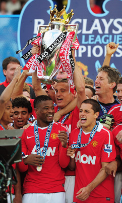 MANCHESTER, ENGLAND - MAY 22:  Captain Nemanja Vidic of Manchester United lifts the Premier League trophy after the Barclays Premier League match between Manchester United and Blackpool at Old Trafford on May 22, 2011 in Manchester, England. Manchester Un
