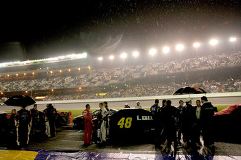 DAYTONA BEACH, FL - FEBRUARY 15:  Drivers and crew members wait out a rain delayduring the NASCAR Sprint Cup Series Daytona 500 at Daytona International Speedway on February 15, 2009 in Daytona Beach, Florida. The race was called at 162 lap due to weather