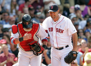 BOSTON, MA  - JUNE 19:  Tim Wakefield #49 and Jarrod Saltalamacchia #39 of the Boston Red Sox share a laugh against of the Milwaukee Brewers at Fenway Park on June 19, 2011 in Boston, Massachusetts.  (Photo by Jim Rogash/Getty Images)