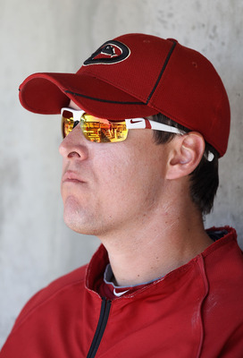 SCOTTSDALE, AZ - MARCH 09:  Kelly Johnson #2 of the Arizona Diamondbacks watches from the dugout during the spring training game against the Milwaukee Brewers at Salt River Fields at Talking Stick on March 9, 2011 in Scottsdale, Arizona.  (Photo by Christ