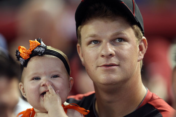 PHOENIX, AZ - JULY 11:  National League All-Star Matt Cain #18 of the San Francisco Giants sits with his daughter Hartley during the 2011 State Farm Home Run Derby at Chase Field on July 11, 2011 in Phoenix, Arizona.  (Photo by Christian Petersen/Getty Im