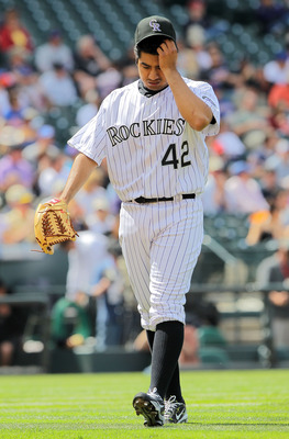 DENVER - APRIL 15:  Starting pitcher Jorge De La Rosa #42 of the Colorado Rockies reacts as he works against the New York Mets at Coors Field on April 15, 2010 in Denver, Colorado. All the players in MLB wore #42 today in honor of Jackie Robinson Day.  (P
