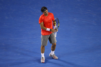 MELBOURNE, AUSTRALIA - JANUARY 26:  Rafael Nadal of Spain shows his emotions in his quarterfinal match against David Ferrer of Spain during day ten of the 2011 Australian Open at Melbourne Park on January 26, 2011 in Melbourne, Australia.  (Photo by Julia