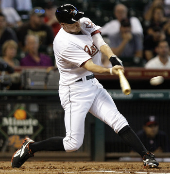 HOUSTON, TX - JULY 20: Hunter Pence #9 of the Houston Astros hits a triple in the first inning against  the Washington Nationals on July 20, 2011 at Minute Maid Park in Houston, Texas. Astros won in the bottom of the 11th 3 - 2. (Photo by Thomas B. Shea/G
