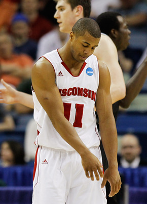 NEW ORLEANS, LA - MARCH 24:  Jordan Taylor #11 of the Wisconsin Badgers reacts after missing a basket against the Butler Bulldogs during the Southeast regional of the 2011 NCAA men's basketball tournament at New Orleans Arena on March 24, 2011 in New Orle