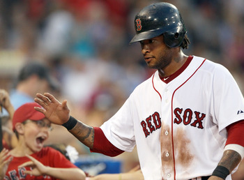 BOSTON, MA - JULY 06:  Darnell McDonald #54 of the Boston Red Sox is congratulated after he scored a run in the fourth inning against the Toronto Blue Jays on July 6, 2011 at Fenway Park in Boston, Massachusetts.  (Photo by Elsa/Getty Images)