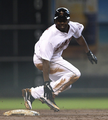 HOUSTON,TX- JULY 16: Michael Bourn #21 of the Houston Astros is called out after being tagged out by shortstop Chase d'Arnaud #12 of the Pittsburgh Pirates in the third inning on July 16, 2011 at Minute Maid Park in Houston, Texas. (Photo by Thomas B. She