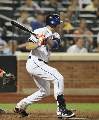 NEW YORK, NY - JULY 19:  Carlos Beltran #15 of the New York Mets hits a eighth inning single against the St. Louis Cardinals at Citi Field on July 19, 2011 in the Flushing neighborhood of the Queens borough of New York City.  (Photo by Jim McIsaac/Getty I