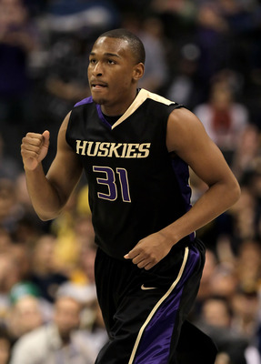 LOS ANGELES, CA - MARCH 13:  Elston Turner #31 of the Washington Huskies pumps his fist in the closing minutes of the second half against the Cal Golden Bears during the championship game of the Pac-10 Basketball Tournament at Staples Center on March 13,
