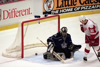 15 Apr 2000: Goalie Jamie Storr #1 of the Los Angeles Kings alows Tomas Helmstrom #96 of the Detroit Red Wings to score during the game at the Joe Louis Arena in Detroit, Michigan. The Red Wings defeated the Kings 8-5.