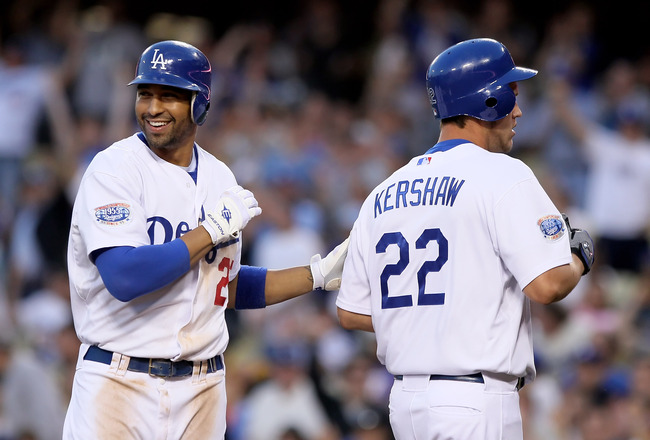 LOS ANGELES, CA - JUNE 04:  Clayton Kershaw #22 of the Los Angeles Dodgers is congratulated by Matt Kemp #27 after scoring a run in the second inning against the Atlanta Braves at Dodger Stadium on June 4, 2010 in Los Angeles, California.  (Photo by Jeff