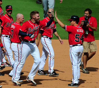 ATLANTA - JULY 17: Freddie Freeman #5 of the Atlanta Braves is congratulated by teammates after knocking in the winning run in the 9th inning against the Washington Nationals at Turner Field on July 17, 2011 in Atlanta, Georgia. (Photo by Scott Cunningham
