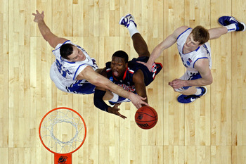 ANAHEIM, CA - MARCH 24:  Solomon Hill #44 of the Arizona Wildcats drives to the basket against Miles Plumlee #21 and Kyle Singler #12 of the Duke Blue Devils of the Duke Blue Devils during the west regional semifinal of the 2011 NCAA men's basketball tour