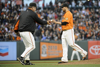 SAN FRANCISCO, CA - JUNE 24: Manager Bruce Bochy #15 of the San Francisco Giants takes the ball from pitcher Jonathan Sanchez #57 against the Cleveland Indians in the fifth inning during a MLB baseball game at AT&T Park June 24, 2011 in San Francisco, Cal
