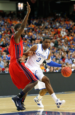 ATLANTA, GA - MARCH 11:  Terrence Jones #3 of the Kentucky Wildcats drives against Terrance Henry #1 of the Ole Miss Rebels during the quarterfinals of the SEC Men's Basketball Tournament at Georgia Dome on March 11, 2011 in Atlanta, Georgia.  (Photo by K