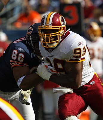 CHICAGO - OCTOBER 24: Andre Carter #99 of the Washington Redskins rushes against Brandon Manumaleuna #86 of the Chicago Bears at Soldier Field on October 24, 2010 in Chicago, Illinois. The Redskins defeated the Bears 17-14. (Photo by Jonathan Daniel/Getty
