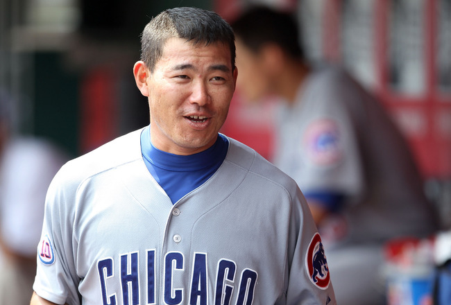 CINCINNATI, OH - JUNE 08:  Kosuke Fukudome #1  of the Chicago Cubs walks in the dugout after scoring a run during the game against the Cincinnati Reds at Great American Ball Park on June 8, 2011 in Cincinnati, Ohio.  (Photo by Andy Lyons/Getty Images)