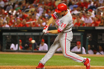 ST. LOUIS, MO - JUNE 22: Chase Utley #26 of the Philadelphia Phillies hits sacrifice RBI against the St. Louis Cardinals at Busch Stadium on June 22, 2011 in St. Louis, Missouri.  (Photo by Dilip Vishwanat/Getty Images)