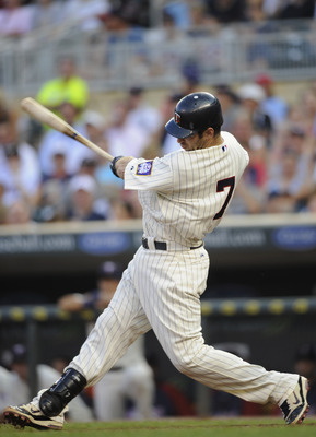 MINNEAPOLIS, MN - JULY 18: Joe Mauer #7 of the Minnesota Twins hits an RBI single against the Cleveland Indians in the third inning of game two in a doubleheader on July 18, 2011 at Target Field in Minneapolis, Minnesota. The Indians defeated the Twins 6-