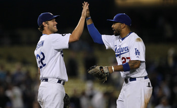 LOS ANGELES, CA - JUNE 20:  Starting pitcher Clayton Kershaw #22 and center fielder Matt Kemp #27 of the Los Angeles Dodgers celebrate after Kershaw's complete game shoutout against the Detroit Tigers on June 20, 2011 at Dodger Stadium in Los Angeles, Cal