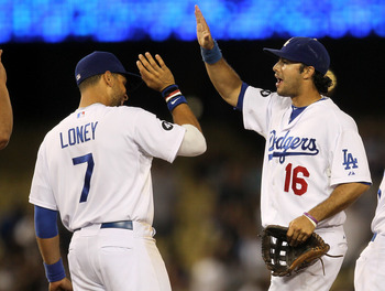LOS ANGELES, CA - JULY 08:  Andre Ethier #16 and James Loney #7 of the Los Angeles Dodgers celebrate after the game with the San Diego Padres on July 8, 2011 at Dodger Stadium in Los Angeles, California. The Dodgers won 1-0.  (Photo by Stephen Dunn/Getty 
