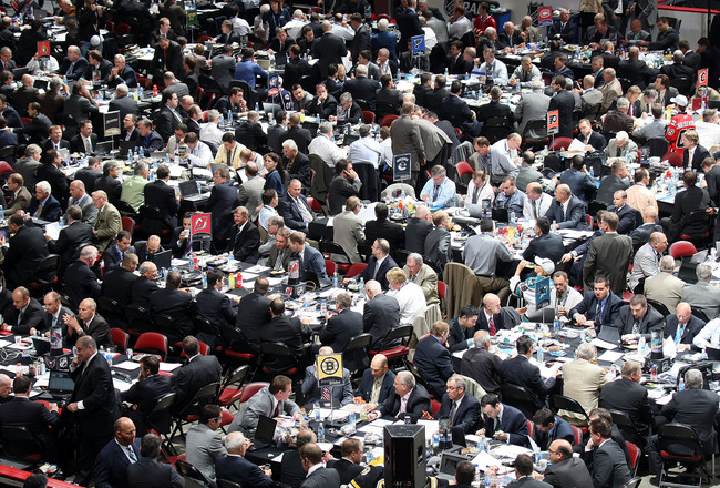 MONTREAL, QC - JUNE 27:  Executies and front office members from multiple NHL teams sit at tables on the draft floor during the 2009 NHL Entry Draft at the Bell Centre on June 27, 2009 in Montreal, Quebec, Canada.  (Photo by Bruce Bennett/Getty Images)