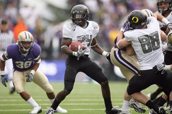 SEATTLE - OCTOBER 24:  Kenjon Barner #24 of the Oregon Ducks carries the ball during the game against the Washington Huskies on October 24, 2009 at Husky Stadium in Seattle, Washington. The Ducks defeated the Huskies 43-19. (Photo by Otto Greule Jr/Getty