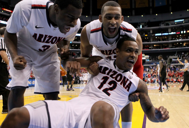 LOS ANGELES, CA - MARCH 12:  Kevin Parrom #3, Jamelle Horne #42 and Lamont Jones #12 of the Arizona Wildcats react after Jones takes a charge in the second half while taking on the Washington Huskies in the championship game of the 2011 Pacific Life Pac-1