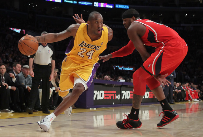 LOS ANGELES, CA - FEBRUARY 22:  Kobe Bryant #24 of the Los Angeles Lakers drives around Josh Smith #5 of the Atlanta Hawks in the first half at Staples Center on February 22, 2011 in Los Angeles, California. NOTE TO USER: User expressly acknowledges and a