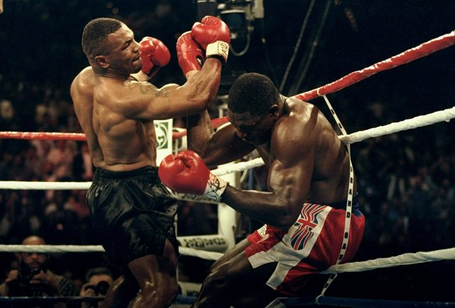 16 Mar 1996: Mike Tyson jabs the winning punch during the third round against Frank Bruno during the WBC Heavyweight Championship at MGM in Las Vegas, Nevada.