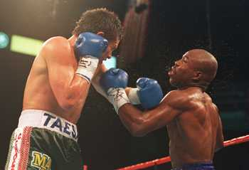 17 SEP 1994:  DEFENDING CHAMPION JULIO CESAR CHAVEZ LANDS A HARD LEFT TO THE CHIN OF  CHALLENGER MELDRICK TAYLOR TONIGHT DURING THE SEVENTH ROUND OF THEIR WBC SUPER LIGHTWEIGHT CHAMPIONSHIP BOUT AT THE MGM GRAND IN LAS VEGAS, NEVADA.   CHAVEZ WENT ON TO K