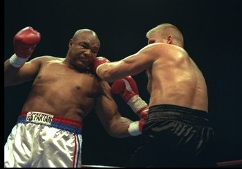 3 Nov 1996:  George Foreman (left) and Crawford Grimsley trade blows during a bout at Tokyo Bay NK Hall in Tokyo, Japan.  Foreman won the fight by a decision in the twelfth round. Mandatory Credit: Al Bello  /Allsport